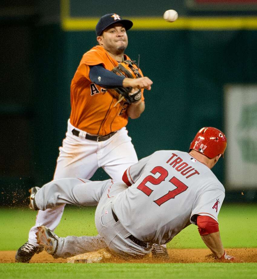 Astros second baseman Jose Altuve makes the relay over Angels center fielder Mike Trout to complete a double play on a grounder by Albert Pujols.