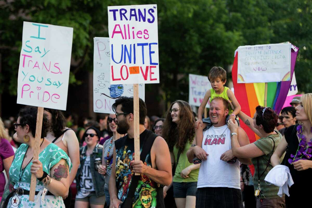 Toting signs with messages of love and acceptance, groups of attendees move down Broadway during the Trans Pride march and celebration Friday, June 28, 2013, in the Capitol Hill neighborhood of Seattle. The event intended to increase the power of the transgender community and its allies, both within and beyond Seattle.