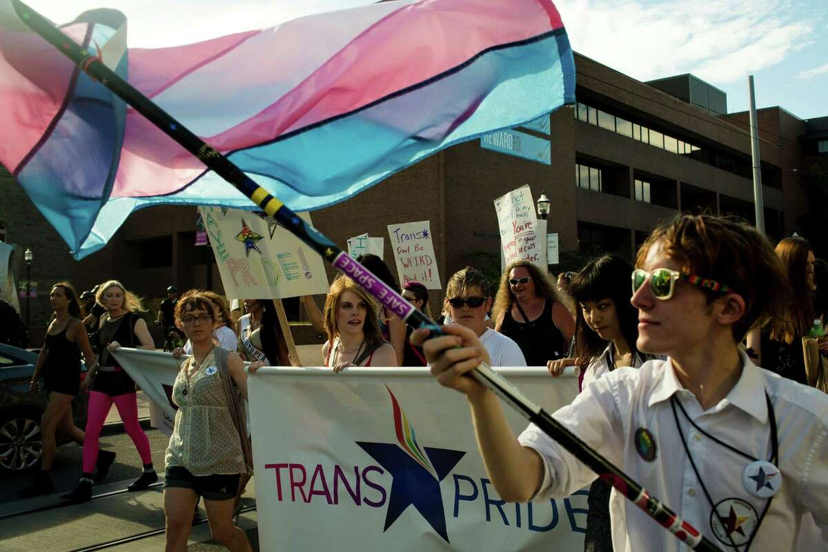 Hundreds of attendees move down Broadway during the Trans Pride march and celebration Friday, June 28, 2013, in the Capitol Hill neighborhood of Seattle. The event intended to increase the power of the transgender community and its allies, both within and beyond Seattle.