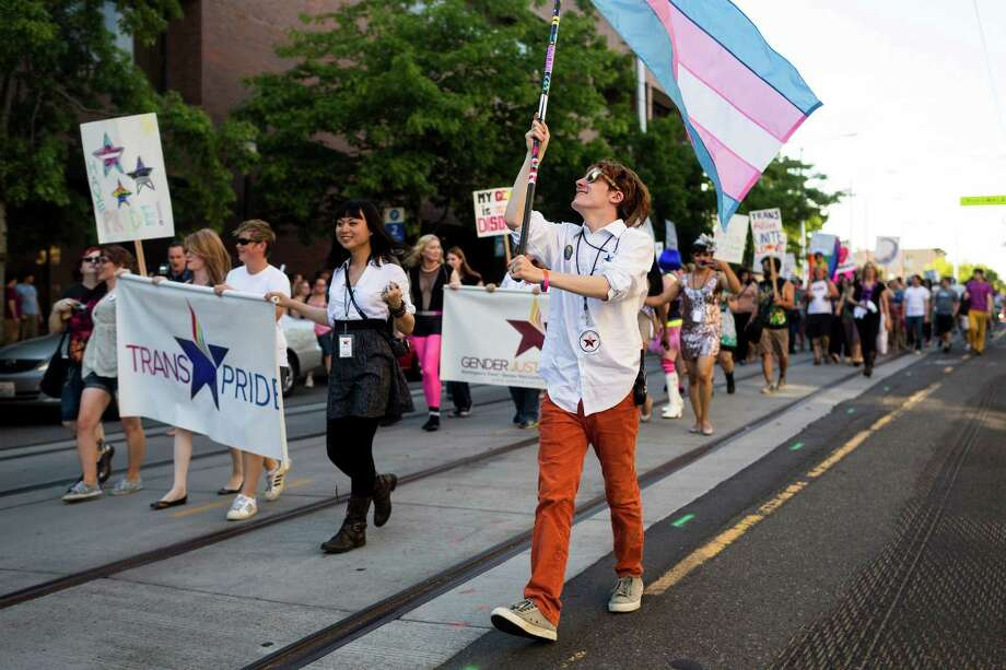 Hundreds of attendees move down Broadway during the Trans Pride march and celebration Friday, June 28, 2013, in the Capitol Hill neighborhood of Seattle. The event intended to increase the power of the transgender community and its allies, both within and beyond Seattle. Photo: JORDAN STEAD, SEATTLEPI.COM / SEATTLEPI.COM