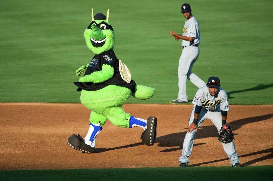 Skeeters mascot Moe rounds the bases between innings during the team's homestand this week. Photo: Smiley N. Pool / © 2013  Smiley N. Pool