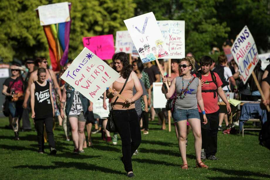 Following the conclusion of the march, attendees gather in Cal Anderson Park during the Trans Pride celebration Friday, June 28, 2013, in the Capitol Hill neighborhood of Seattle. The event intended to increase the power of the transgender community and its allies, both within and beyond Seattle. Photo: JORDAN STEAD, SEATTLEPI.COM / SEATTLEPI.COM