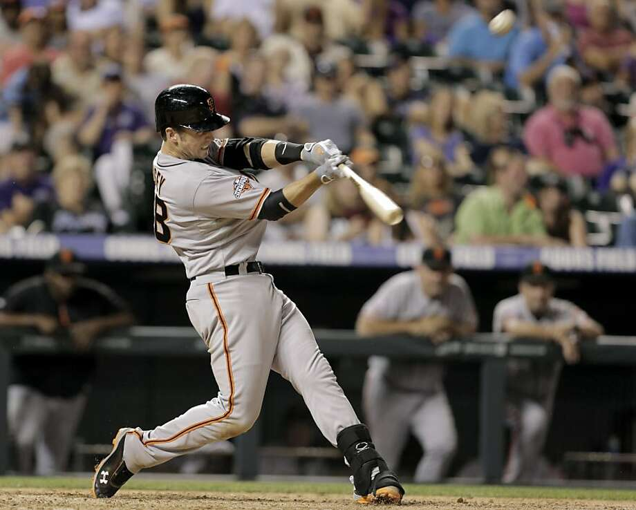 Buster Posey spares the Giants from a second consecutive shutout in Denver with his solo homer in the ninth inning. Photo: Joe Mahoney, Associated Press