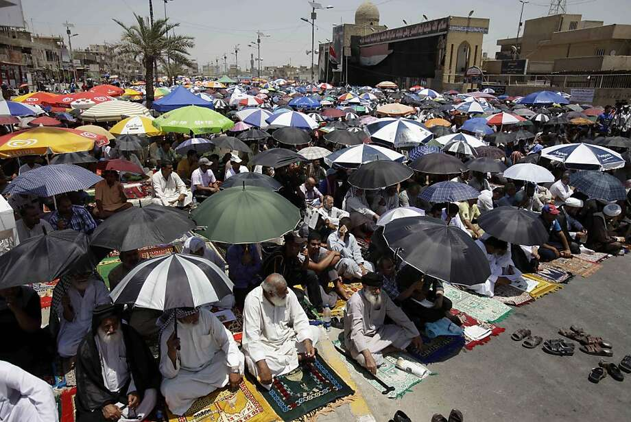 Followers of radical Shiite cleric Muqtada al-Sadr attend Friday prayers in the Sadr City neighborhood in Baghdad, Iraq, Friday, June 28, 2013. (AP Photo/Karim Kadim) Photo: Karim Kadim, Associated Press