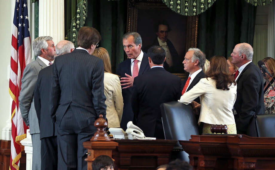 Lt. Governor David Dewhurst meets with leaders on the podium as the Senate considers passage of the abortion bill passed earlier in the House in Austin on June 24, 2013. Photo: For The San Antonio Express-News