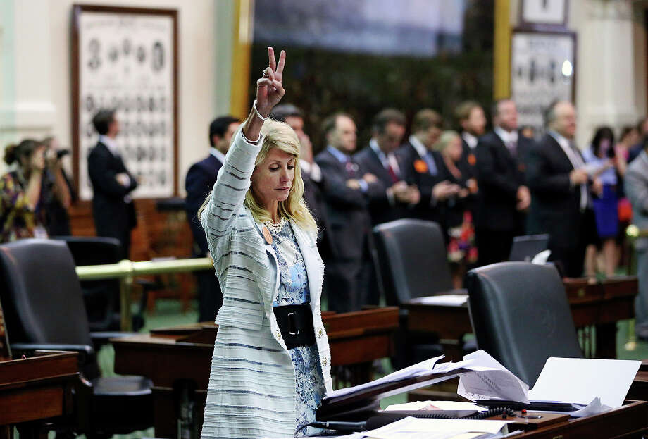 Fort Worth Senator Wendy Davis signals a no vote after she filibusters in an effort to cause abortion legislation to die without a vote on the floor of the Senate Tuesday, June 25, 2013. Photo: For The San Antonio Express-News