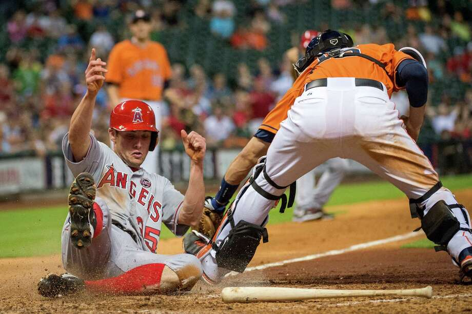 Angels pinch runner Peter Bourjos scores ahead of the tag of Astros catcher Jason Castro to give the Angels a 2-1 lead in the eighth inning. They added two runs in the ninth for the winning margin. Photo: Smiley N. Pool / © 2013  Smiley N. Pool