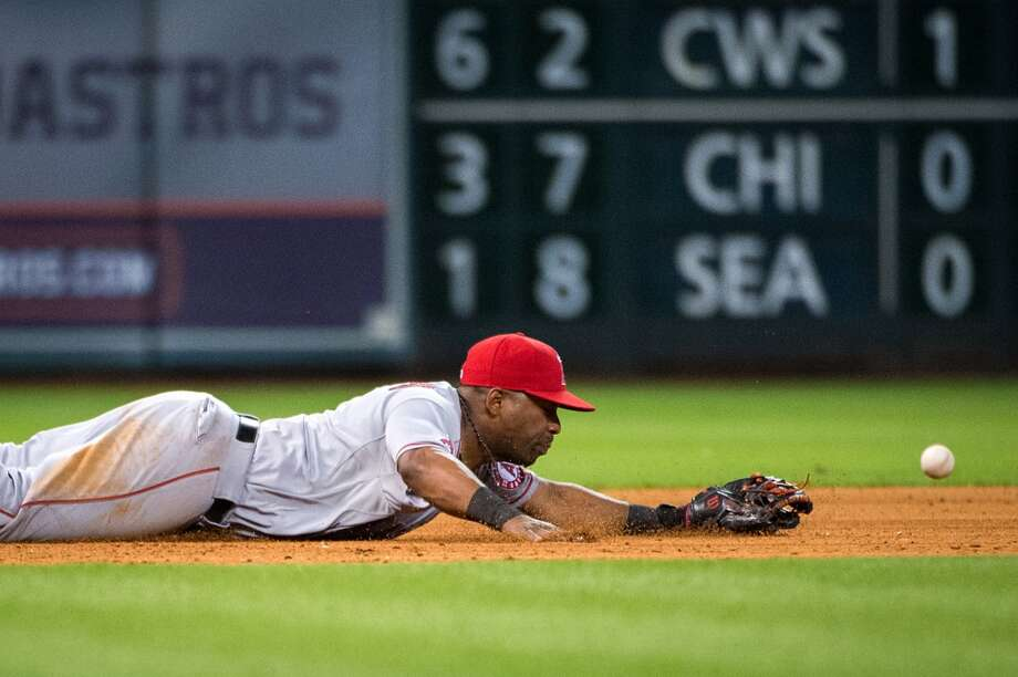 Angels shortstop Erick Aybar can't get to a single off the bat of Astros first baseman Brett Wallace during the eighth inning.