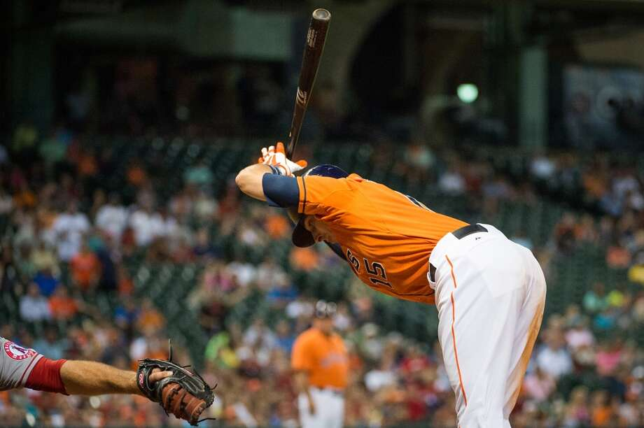 Astros catcher Jason Castro backs away from an inside pitch during the eighth inning.