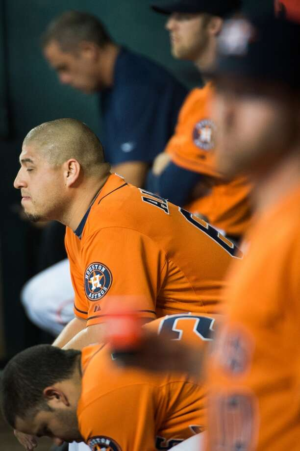 Astros relief pitcher Hector Ambriz sits in the dugout after leaving the game.