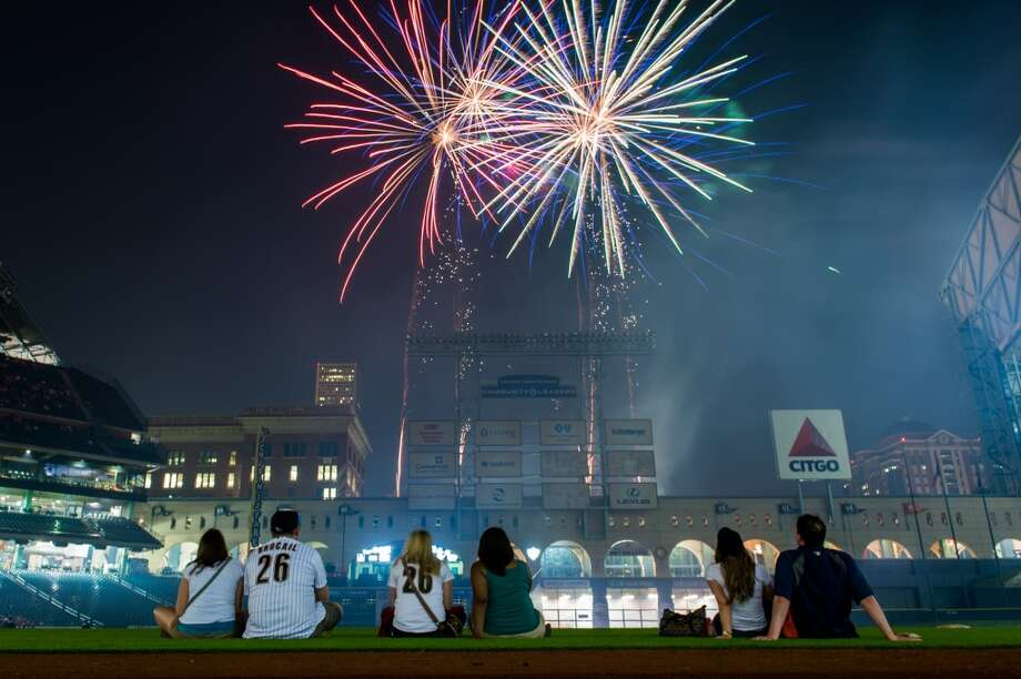 Fireworks explode over Minute Maid Park after the Astros game against the Los Angeles Angels.