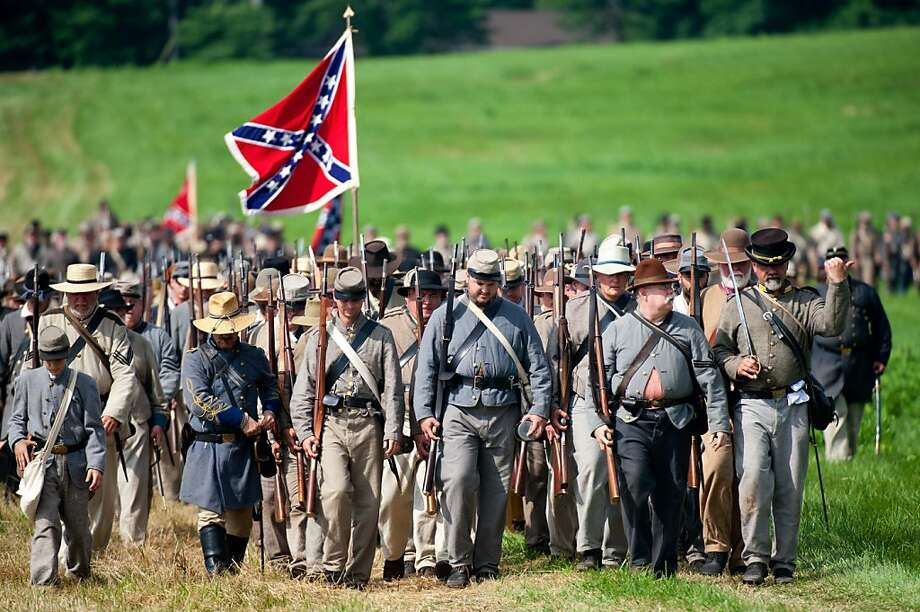 Confederate troops march into position during a re-enactment of the Battle of Gettysburg on June 28, 2013 at the start of the 150th Gettysburg celebration and re-enactments in Gettysburg, Pennsylvania. Over three days, more than 10,000 re-enactors will pay tribute the major battles that took place in Gettysburg during the 1861-1865 US Civil War. /AFP PHOTO / Karen BLEIERKAREN BLEIER/AFP/Getty Images Photo: Karen Bleier, AFP/Getty Images