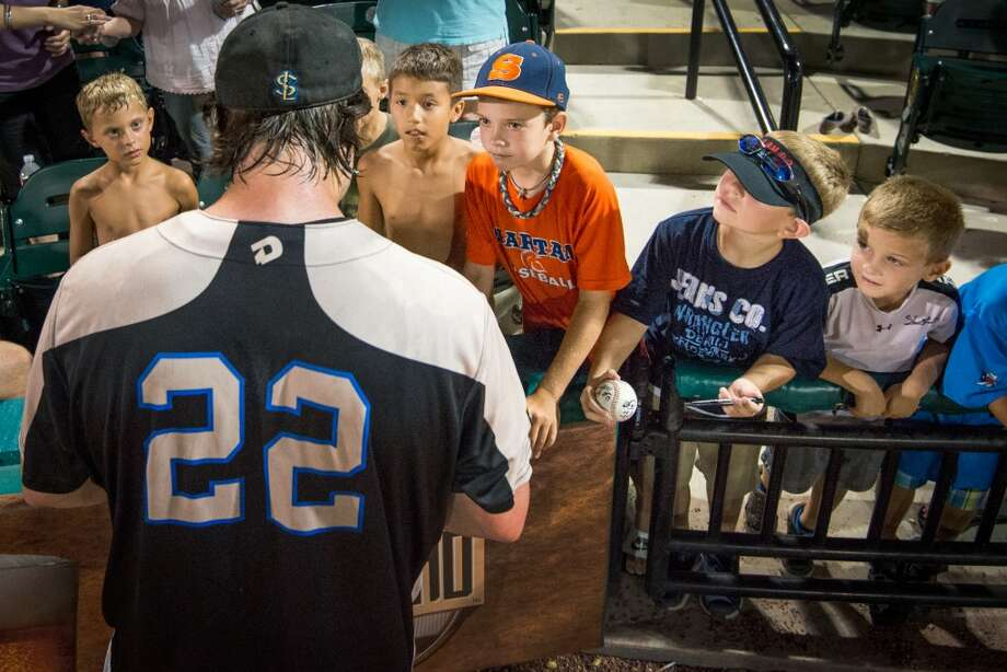 Skeeters catcher Koby Clemens signs autographs for fans after a victory over the York Revolution. Clemens hit a three-run homer in the bottom of the ninth to give the Skeeters 12-11 walk-off win. Photo: Smiley N. Pool, Houston Chronicle
