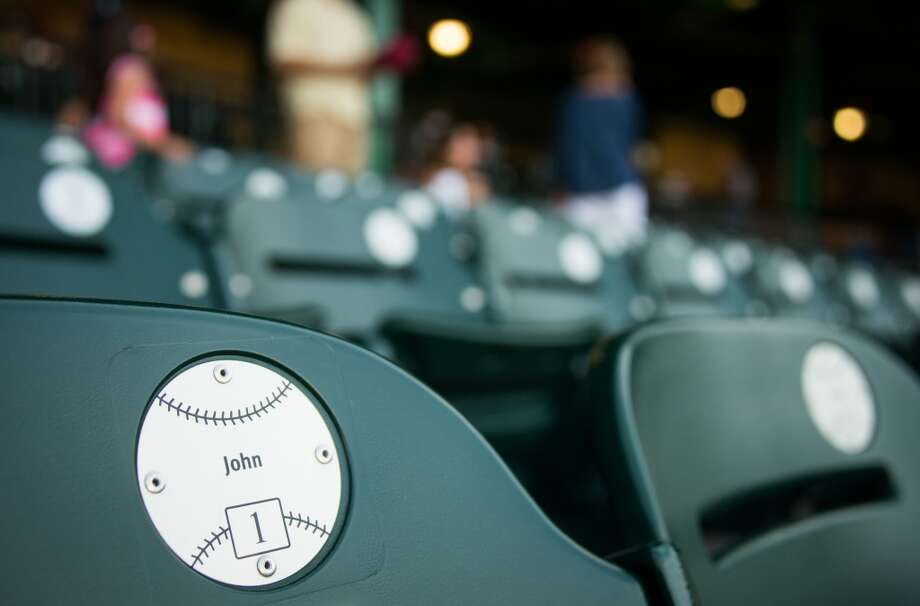 Seat emblems bear the names of season ticket holders as fans arrive before the game. Photo: Smiley N. Pool, Houston Chronicle