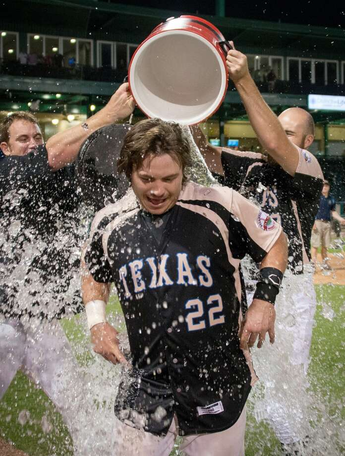 Skeeters catcher Koby Clemens is doused with water by his teammates after a victory over the York Revolution. Photo: Smiley N. Pool, Houston Chronicle
