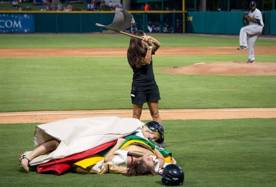 Fans participate in a promotion between innings. Photo: Smiley N. Pool, Houston Chronicle