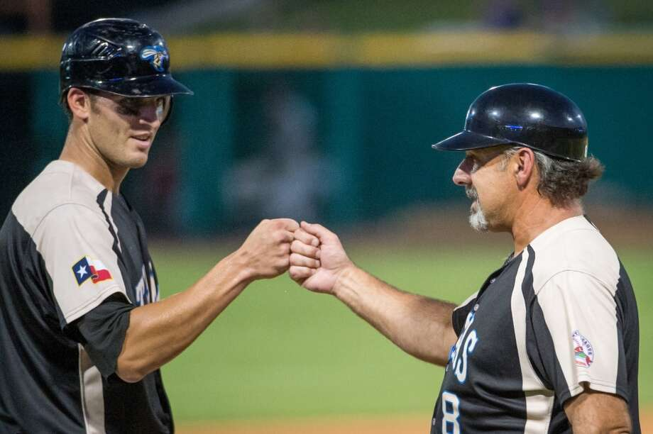 Skeeters manager Gary Gaetti, right, congratulates Aaron Bates during a game against the York Revolution. Photo: Smiley N. Pool, Houston Chronicle