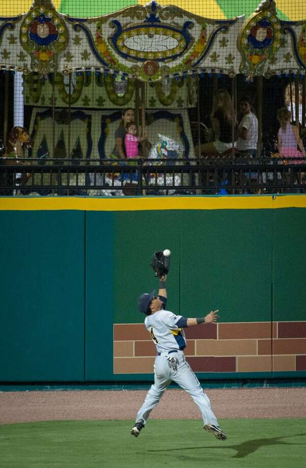 York Revolution outfielder Eric Patterson makes a catch in front of the carousel in left field. Photo: Smiley N. Pool, Houston Chronicle