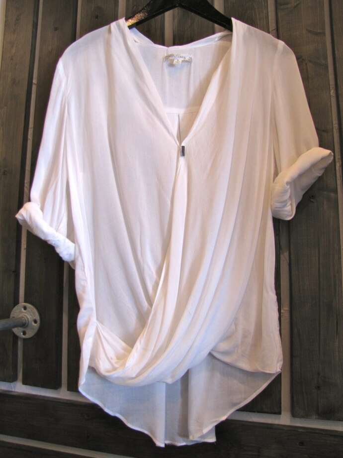Ivory draped top, $31.99, The Purple Door, Beaumont