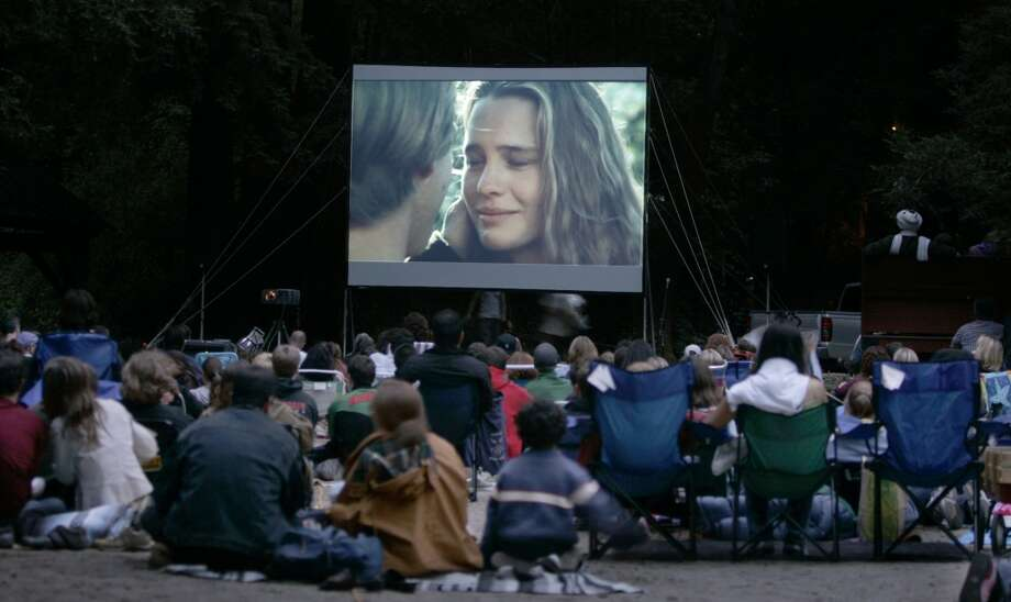 You can take the family to the movies any time of year. Make it special in the summer by packing up the fold-up chairs and heading to an outdoor movie night showing an old favorite.