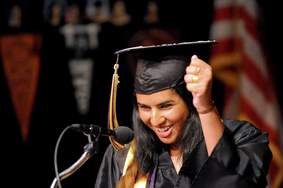 Valedictorian Maria Ijaz pumps her fist after addressing fellow graduates during Albany Leadership Charter High School for Girls commencement exercises on Friday, June 28, 2013, at The Egg in Albany, N.Y. This is the charter school's first graduating class, and all 18 graduates are going on to college. (Cindy Schultz / Times Union) Photo: Cindy Schultz / 00023007A