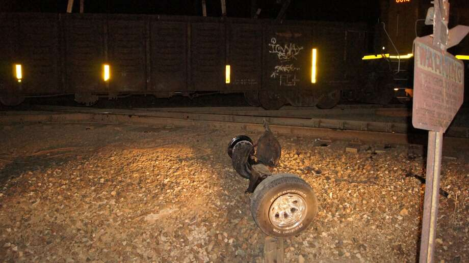 The train was able to stop almost one half mile down the track where it ejected the rear axle from the truck.