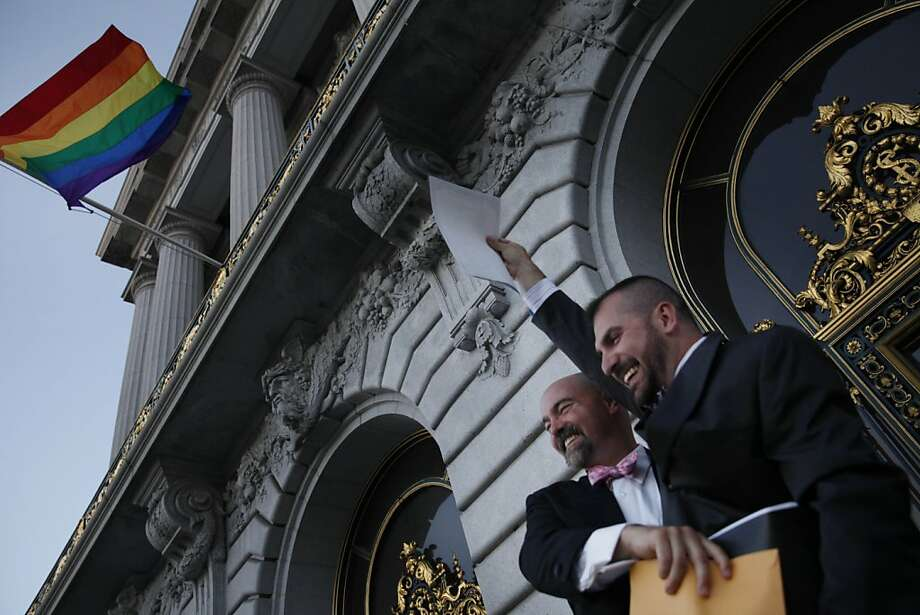 Christopher Hagenmeier (l to r) and Gregoire Venier, both of San Francisco, hold their marriage license in the air outside of City Hall after being married at City Hall on Friday, June 28, 2013 in San Francisco,  Calif. Photo: Lea Suzuki, The Chronicle