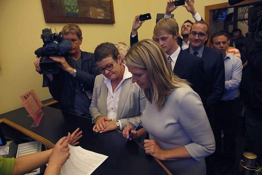 June 28, 2013: Lead plaintiffs in the Prop 8 case, Kris Perry, left, and Sandy Stierget apply for their their marriage license at the County Clerk's office in San Francisco. Photo: Lea Suzuki, The Chronicle