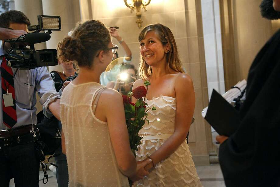 Jacqueline Bialostozky (in glasses) and Jessica Becker get married at City Hall in San Francisco, Calif., on Friday, June 28, 2013. Photo: Preston Gannaway, Special To The Chronicle