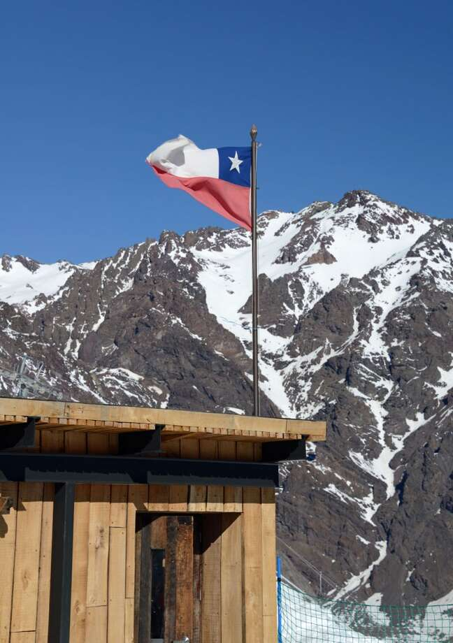 The Chilean flag flies proudly on portillo's hills.