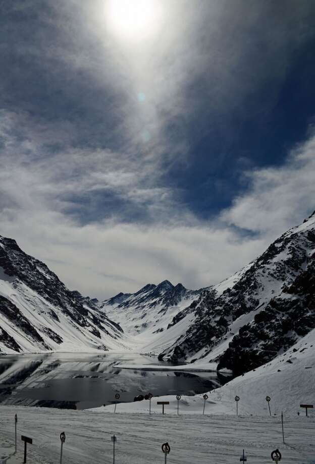 The sun shines high over Laguna del Inca.