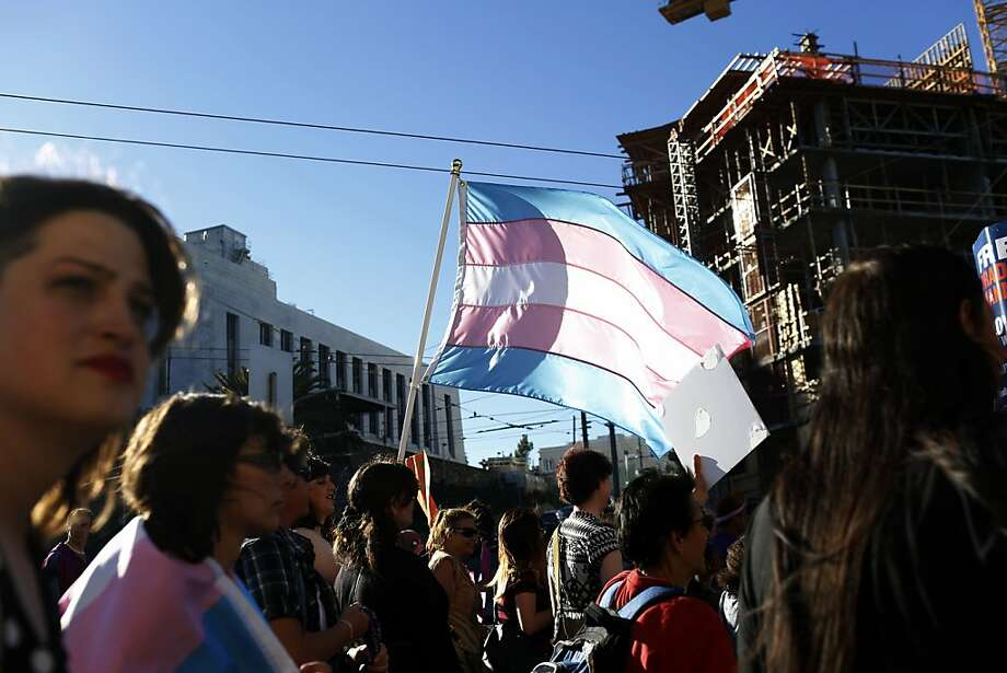 Transgender people and supporters march down Market Street waving transgender pride flags during the Trans March. Photo: Ian C. Bates, The Chronicle