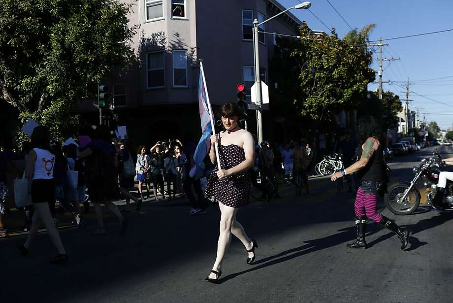Alesis Alexander runs across Dolores Street holding a transgender pride flag during the Trans March in Dolores Park in San Francisco, Calif. on June 28, 2013. Photo: Ian C. Bates, The Chronicle