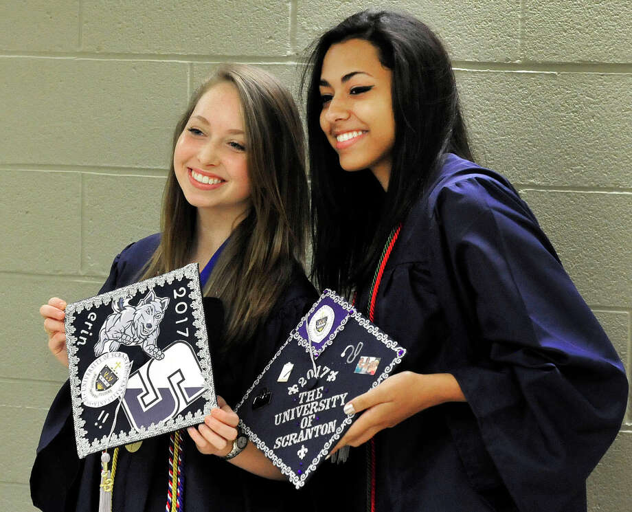 Erin Mannion, left, and Lauren Garel, proudly display their caps as New Fairfield High School holds commencement exercises at the O'Neill Center, on the campus of Western Connecticut State University in Danbury, Conn. Saturday, June 29, 2013. Photo: Michael Duffy / The News-Times