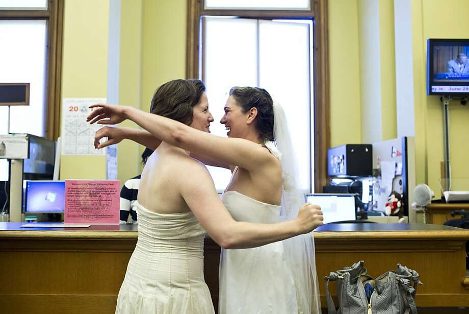 Elizabeth Carey (left) and Cynthia Wides of Oakland hug as they get their marriage license at City Hall. Photo: Jason Henry, Special To The Chronicle