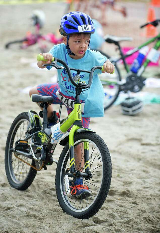 Kids compete in the bike portion of Saturday's KIC-IT kid's triathalon at Cove Island Park on June 29, 2013. Photo: Lindsay Perry / Stamford Advocate