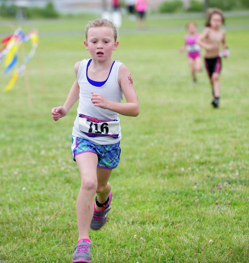 Kids compete in the run portion of Saturday's KIC-IT kid's triathalon at Cove Island Park on June 29, 2013. Photo: Lindsay Perry / Stamford Advocate