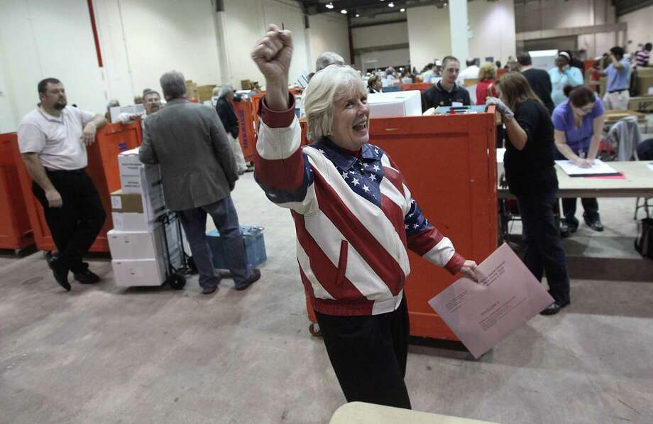 Election Judge Alice Rekeweg celebrates after submitting votes at Reliant Arena where the Harris County Clerk's Office was overseeing the vote count on Nov. 2, 2010, in Houston. Polls suggest Americans are increasingly jaded about politics and government. Photo: Mayra Beltran, Staff / Houston Chronicle