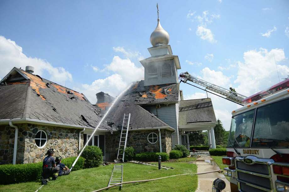 Firefighters work to extinguish the blaze at St. Nicholas Byzantine Catholic Church in Danbury, Conn. on Saturday, June 29, 2013.  The church suffered extremely heavy roof and interior damage. Photo: Tyler Sizemore / The News-Times