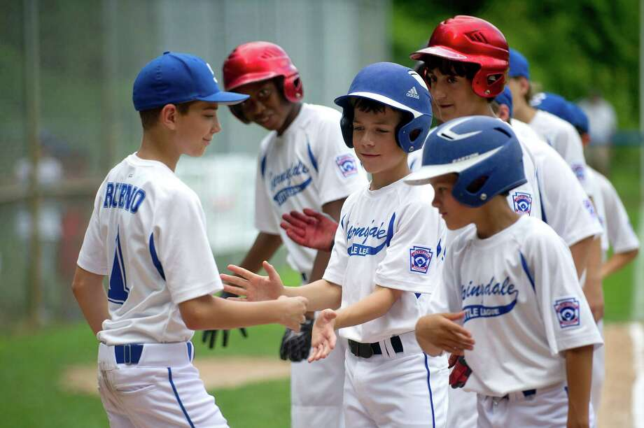 Springdale players are introduced before Saturday's Little League game between North Stamford and Springdale on June 29, 2013. Photo: Lindsay Perry / Stamford Advocate