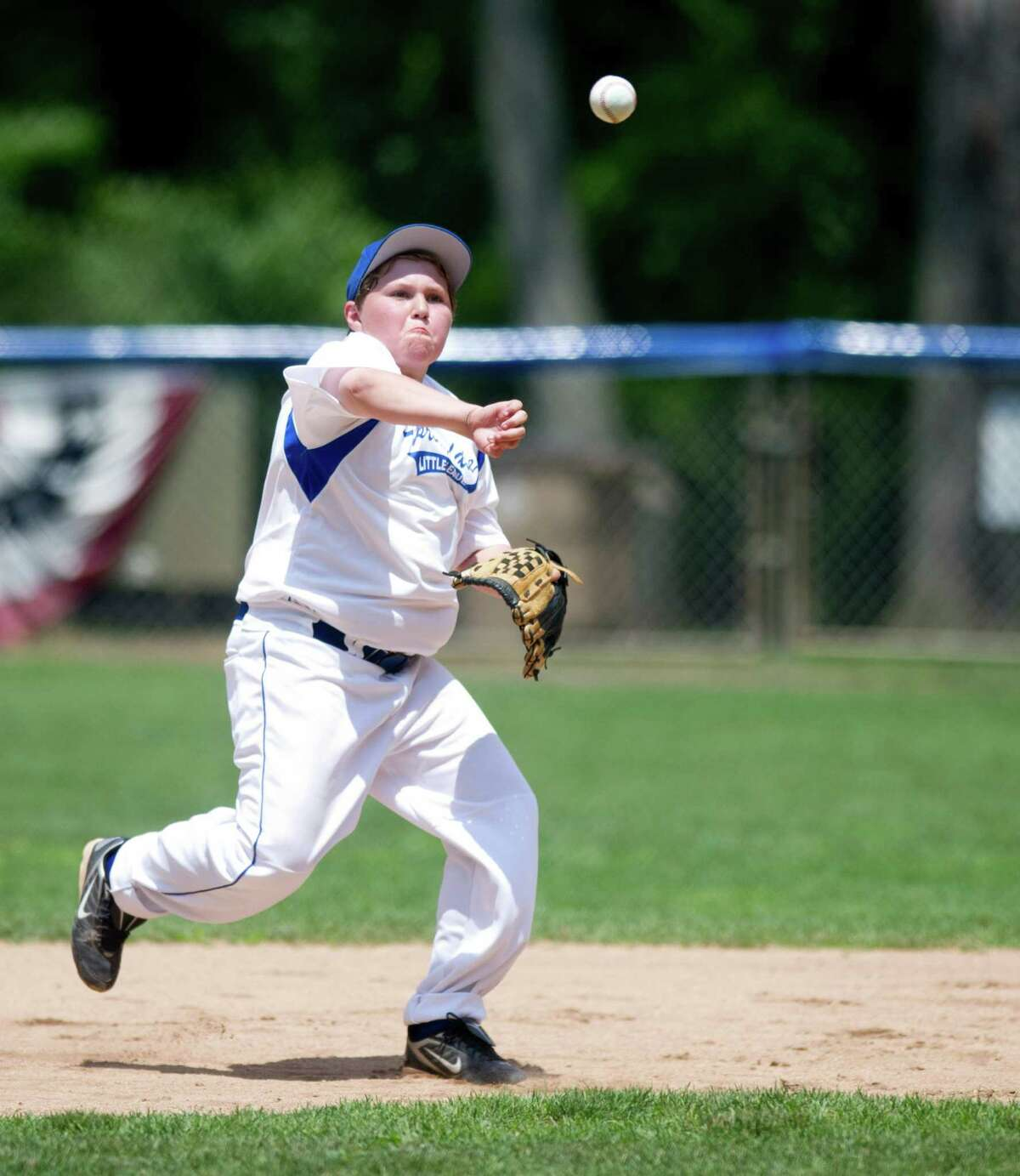Springdale's Ryan Lionetti throws to first for an out during Saturday's Little League game between North Stamford and Springdale on June 29, 2013.
