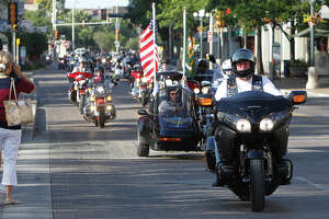 A Green Beret motorcycle ride passes in front of the Alamo at the beginning of a wreath-laying ceremony by the Special Forces Association on Saturday, June 29, 2013.  The ride started at the Alamodome and then deaded through the Texas Hill Country on a scenic ride to Luckenbach.  Active and veteran U.S. Army Green Berets from across the nation gathered at the Alamo to pay tribute to fallen soldiers, including those who died at the Alamo in 1836.  MARVIN PFEIFFER/ mpfeiffer@express-news.net