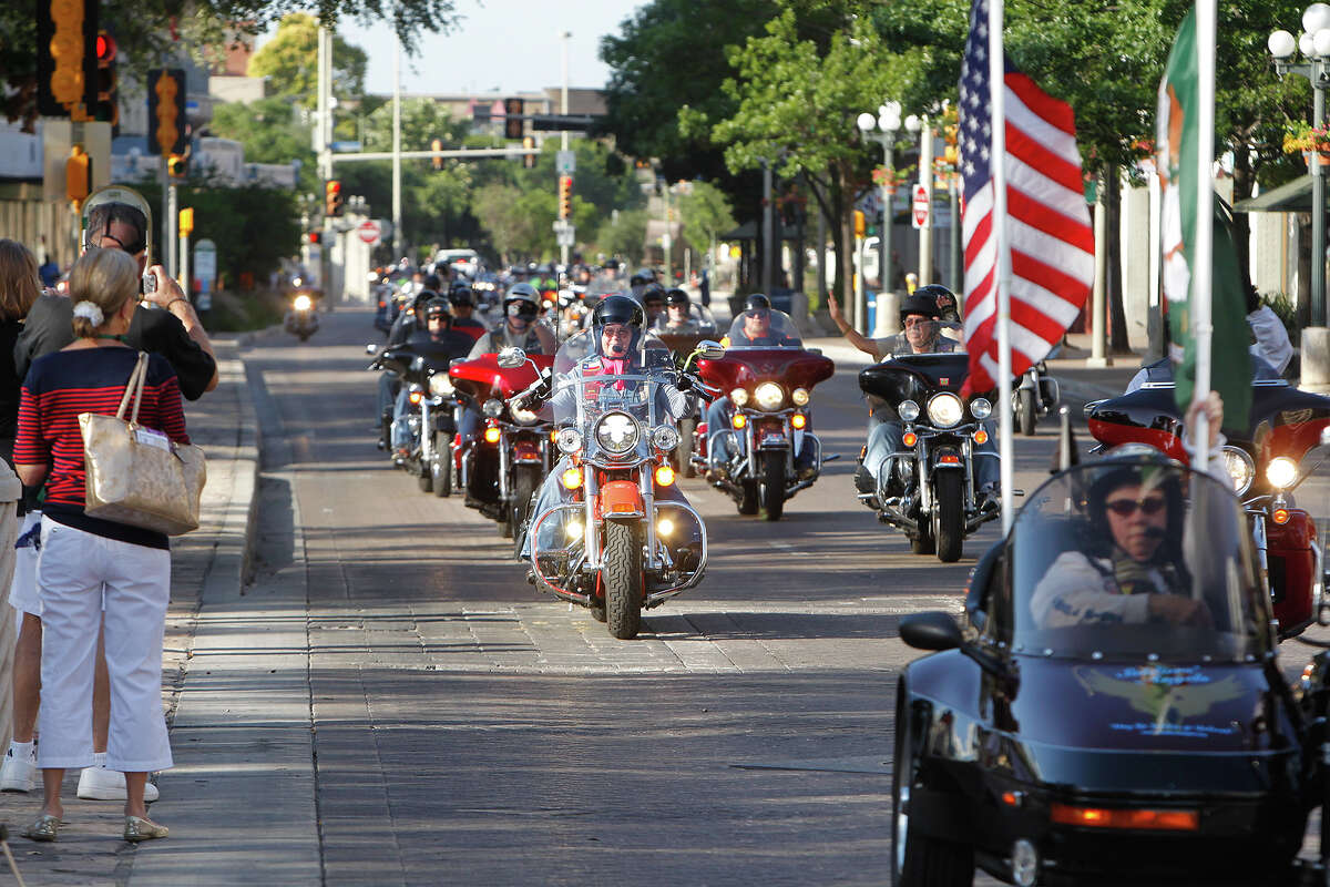 A Green Beret motorcycle procession passes in front of the Alamo at the beginning of a wreath-laying ceremony by the Special Forces Association on Saturday, June 29, 2013. The ride started at the Alamodome and then went through the Texas Hill Country on a scenic ride to Luckenbach. Active and veteran U.S. Army Green Berets from across the nation gathered at the Alamo to pay tribute to fallen soldiers, including those who died at the Alamo in 1836.