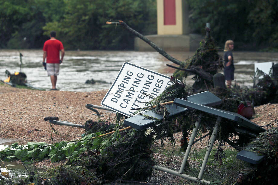 Spectators make it down to the water to view damage after the Guadalupe River and Comal rivers flow over their banks in New Braunfels  on October 31, 2013. Photo: TOM REEL