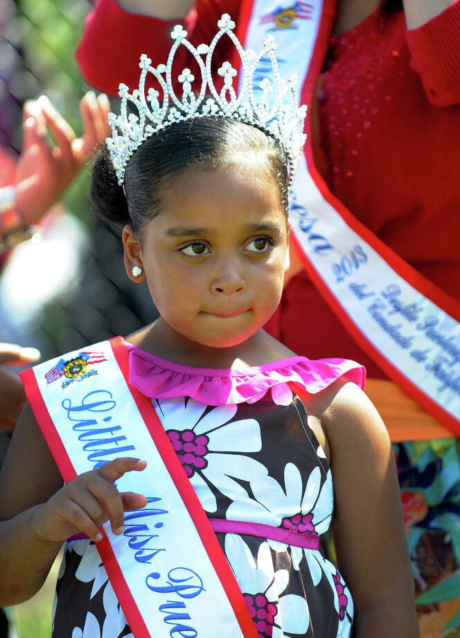 Little Miss Puerto Rico 2013 Jeydalis Soto, 6, is part of the Puerto Rican Royal Court who were announced at the Bridgeport Caribe Youth Leaders' Caribe Day event at Seaside Park in Bridgeport, Conn. on Saturday June 29, 2013. Photo: Christian Abraham / Connecticut Post