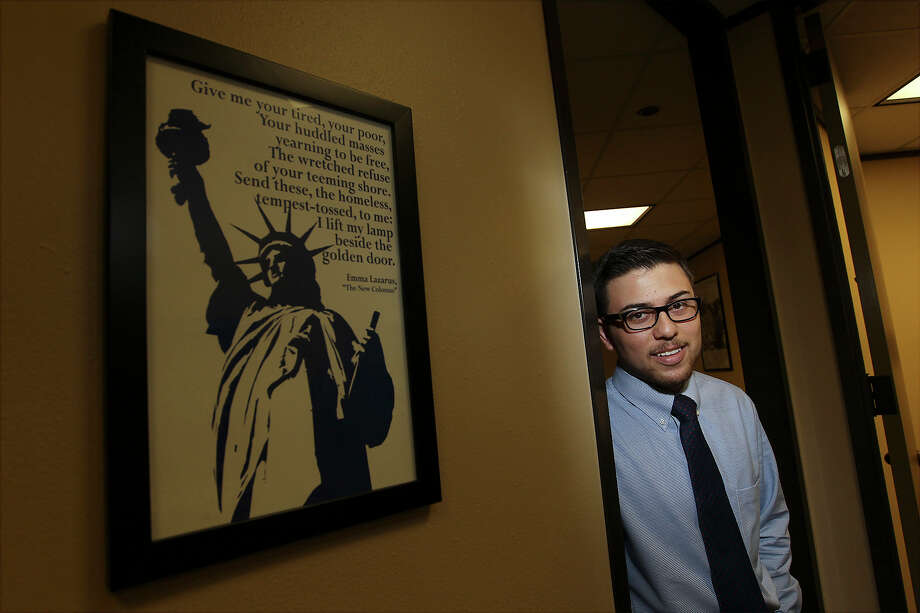 Carlos Aguilar works as a paralegal at a law office in San Antonio. Aguilar, 22, who is from Guanajuato, Mexico was granted residency in the United States through the Deferred Action for Childhood Arrivals program. Photo: Kin Man Hui, San Antonio Express-News / ©2013 San Antonio Express-News