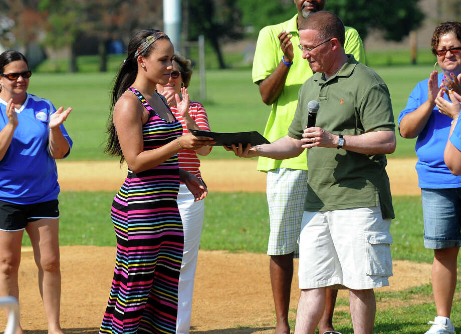 Caroline Centeno is given scholarship money from Walter Diaz, of Eastern Connecticut State University as part of the Bridgeport Caribe Youth Leaders' Caribe Day event at Seaside Park in Bridgeport, Conn. on Saturday June 29, 2013. Photo: Christian Abraham / Connecticut Post