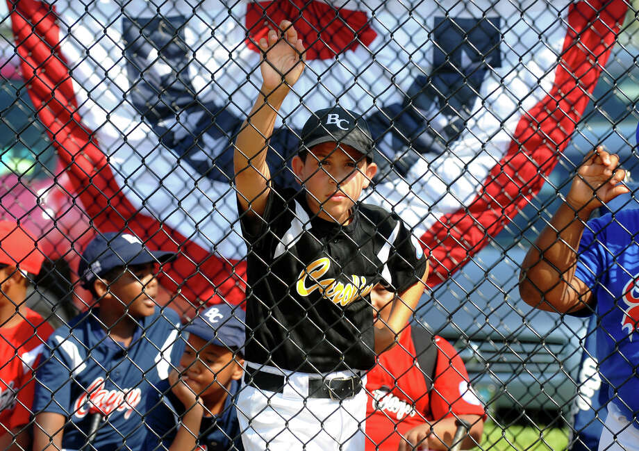 Little leaguer Nathaniel Otero watches the pre-game festivities during the Bridgeport Caribe Youth Leaders' Caribe Day event at Seaside Park in Bridgeport, Conn. on Saturday June 29, 2013. Photo: Christian Abraham / Connecticut Post