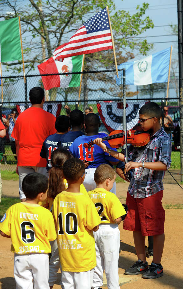 Curtis Gongora plays the National Anthem on his violin during the Bridgeport Caribe Youth Leaders' Caribe Day event at Seaside Park in Bridgeport, Conn. on Saturday June 29, 2013. Photo: Christian Abraham / Connecticut Post