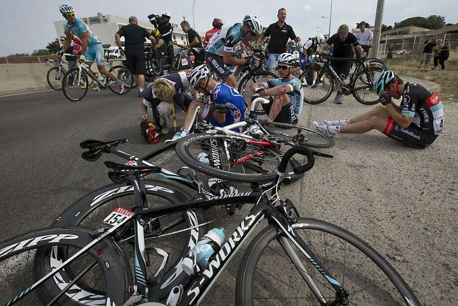 The wreck collected Brazil's Murilo Antoniobil (center left), Germany's Tony Martin and France's Tony Gallopin. Photo: Joel Saget, Associated Press